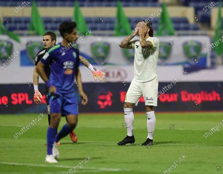 Al-Ittihad player Aleksandar Prijovic (R) reacts during the Saudi Professional League soccer match between Al-Fateh and Al-Ittihad at Prince Abdullah bin Jalawi Stadium, in Hasa, Saudi Arabia, 24 October 2020.