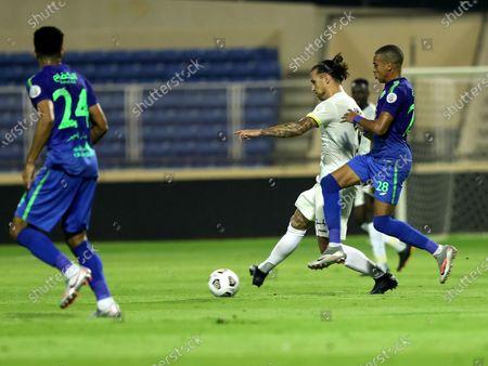Al-Ittihad player Aleksandar Prijovic (2-R) in action against Al-Fateh player Sofiane Bendebka (R) during the Saudi Professional League soccer match between Al-Fateh and Al-Ittihad at Prince Abdullah bin Jalawi Stadium, in Hasa, Saudi Arabia, 24 October 2020.