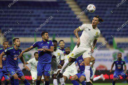 Al-Ittihad player Aleksandar Prijovic (R) in action during the Saudi Professional League soccer match between Al-Fateh and Al-Ittihad at Prince Abdullah bin Jalawi Stadium, in Hasa, Saudi Arabia, 24 October 2020.