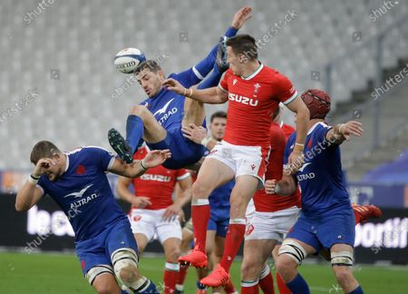 Josh Adams of Wales and France's Anthony Bouthier contest a high ball during the rugby union international match between France and Wales at the Stade de France in Saint-Denis, near Paris, France