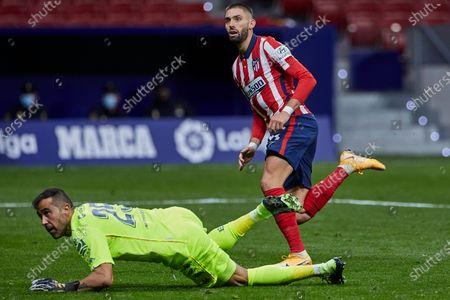 Yannick Carrasco of Atletico de Madrid and Claudio Bravo of Real Betis
