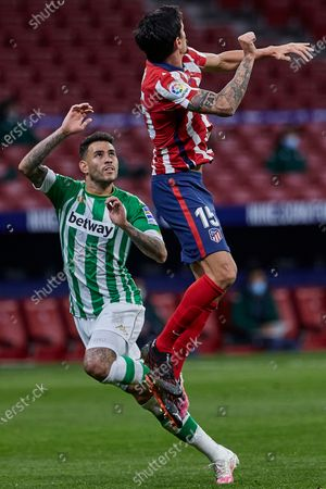 Alex Moreno of Real Betis and Stefan Savic of Atletico de Madrid
