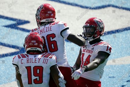 North Carolina State wide receiver Emeka Emezie (86) is conghratulated by wide receiver C.J. Riley (19) and wide receiver Porter Rooks (14) following a touchdown against North Carolina during the first half of an NCAA college football game in Chapel Hill, N.C