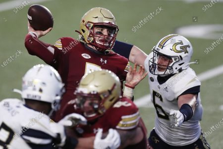 Stock Picture of Boston College quarterback Phil Jurkovec, top left, passes under pressure from Georgia Tech linebacker David Curry (6) during the first half of an NCAA college football game, in Boston