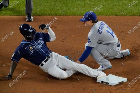 Tampa Bay Rays' Randy Arozarena gets tagged out stealing by Los Angeles Dodgers second baseman Enrique Hernandez during the first inning in Game 4 of the baseball World Series, in Arlington, Texas