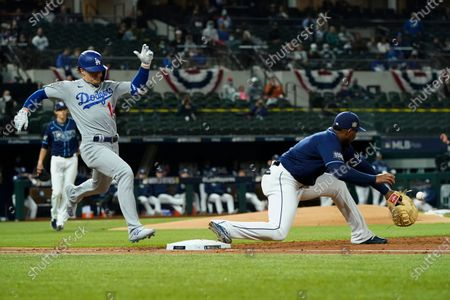 Los Angeles Dodgers' Enrique Hernandez is forced out at first by Tampa Bay Rays first baseman Yandy Diaz during the third inning in Game 4 of the baseball World Series, in Arlington, Texas