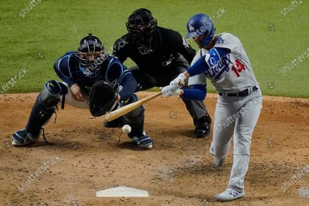 Los Angeles Dodgers' Enrique Hernandez hits a RBI-double against the Tampa Bay Rays during the sixth inning in Game 4 of the baseball World Series, in Arlington, Texas