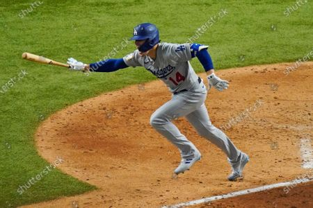 Los Angeles Dodgers' Enrique Hernandez celebrates a RBI-double against the Tampa Bay Rays during the sixth inning in Game 4 of the baseball World Series, in Arlington, Texas