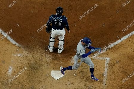 Los Angeles Dodgers' Chris Taylor celebrates after scoring on a single by Corey Seager during the eighth inning in Game 4 of the baseball World Series against the Tampa Bay Rays, in Arlington, Texas