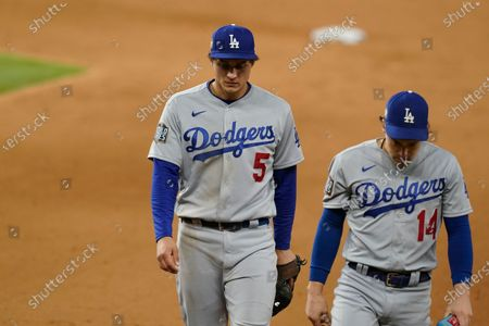 Stock Photo of Los Angeles Dodgers shortstop Corey Seager (5) and Enrique Hernandez walk off the field after Game 4 of the baseball World Series, in Arlington, Texas. Rays defeated the Dodgers 8-7 to tie the series 2-2 games