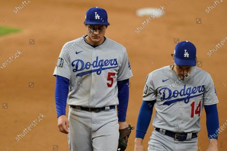 Stock Image of Los Angeles Dodgers shortstop Corey Seager (5) and Enrique Hernandez walk off the field after Game 4 of the baseball World Series, in Arlington, Texas. Rays defeated the Dodgers 8-7 to tie the series 2-2 games