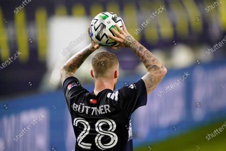 New England Revolution defender Alexander Buttner (28) puts the ball in play during the first half of an MLS soccer match against Nashville SC, in Nashville, Tenn