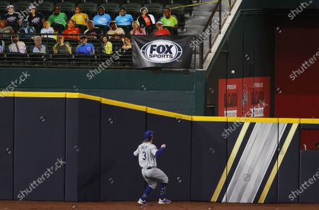 Los Angeles Dodgers left fielder Chris Taylor watches Tampa Bay Rays batter Brandon Lowe's three-run home run land in the bullpen the bottom of the sixth inning of Major League Baseball's World Series Game four at Globe Life Field in Arlington, Texas, USA, 24 October 2020.