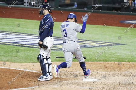 Los Angeles Dodgers baserunner Chris Taylor (R) reacts as he scores behind Tampa Bay Rays catcher Mike Zuninno (L) on batter Corey Seager's RBI single in the top of the eighth inning of Major League Baseball's World Series Game four at Globe Life Field in Arlington, Texas, USA, 24 October 2020.