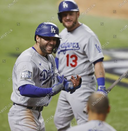 Los Angeles Dodgers baserunner Chris Taylor (L) reacts after scoring on batter Corey Seager's RBI single in the top of the eighth inning of Major League Baseball's World Series Game four at Globe Life Field in Arlington, Texas, USA, 24 October 2020.