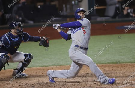Los Angeles Dodgers batter Corey Seager hits an RBI single against the Tampa Bay Rays in the top of the eighth inning of Major League Baseball's World Series Game four at Globe Life Field in Arlington, Texas, USA, 24 October 2020.