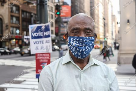 Stock Photo of Greg Russell waits in line to cast his vote on the first day of early voting in New York City at Madison Square Garden