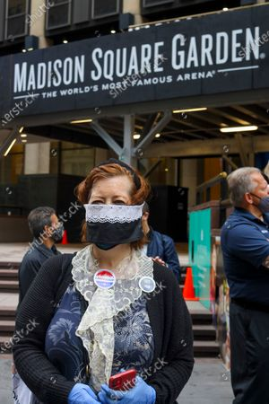 A voter wearing a Ruth Bader Ginsburg Masks waited 4 hours to cast her vote on the first day of early voting in New York City at Madison Square Garden, which was turned into a polling site for the first time