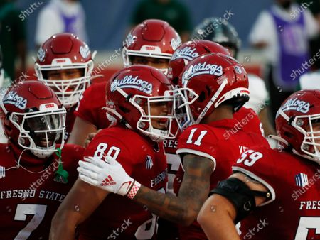 Fresno State tight end Juan Rodriguez, center, celebrates his touchdown against Hawaii with teammate Josh Kelly during the first half of an NCAA college football game in Fresno, Calif