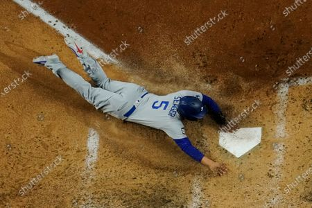 Los Angeles Dodgers' Corey Seager scores past Tampa Bay Rays catcher Mike Zunino during the fifth inning in Game 4 of the baseball World Series, in Arlington, Texas