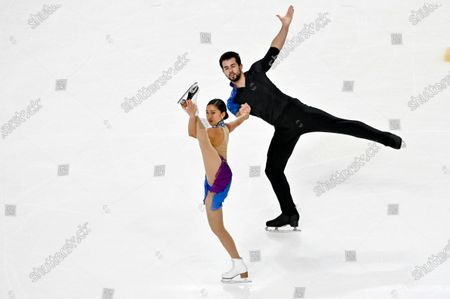 Jessica Calalang and Brian Johnson of the United States compete during the pairs free skating program in the International Skating Union Grand Prix of Figure Skating Series, in Las Vegas