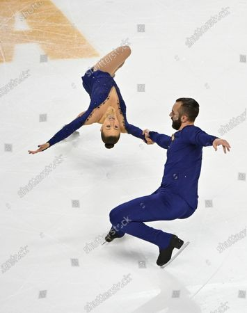 Stock Photo of Ashley Cain-Gribble and Timothy Leduc of the United States compete during the pairs free skating program in the International Skating Union Grand Prix of Figure Skating Series, in Las Vegas