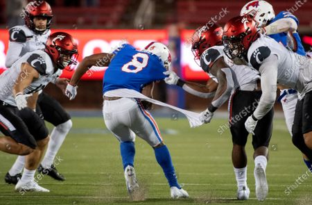 Cincinnati's Jaheim Thomas grabs the shirt of SMU kick returner Bryan Massey (8) on a kickoff return during the second half of an NCAA college football game, in Dallas. Cincinnati won 42-13