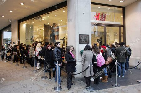H&m / Customer Frenzy At H&m Oxford Circus Branch As The Roberto Cavelli Collection Goes On Sale. Customer Frenzy At Oxford Circus Branch As The Roberto Cavalli Collection Goes On Sale In H&m Stores Today A Collection By Roberto Cavalli For High Street Store H&m Flew Off The Shelves As It Went On Sale Today. About 300 Fans Of The Italian Designer Known For His Evening Wear And Who Is A Favourite With Victoria Beckham Beyonca And Jennifer Lopez Queued From As Early As 5am To Get Their Hands On An Affordable Version Of One Of His Trademark Animal Print Dresses. Within An Hour Of The Flagship Oxford Street Store Opening Shoppers Had Cleared All The Accessories In The Collection. A Gold Sequin Dress Priced At A149.99 Also Sold Out. A Spokesman Said The Company Was Likely To Have Completely Sold Out By The End Of The Day. Cavalli Follows Stella Mccartney And Karl Lagerfeld Who Have Also Designed One-off Collections For The Swedish Store. Fashion Students Leigh Herbert And Daniel Hull Both 20 Were Two Of The First People To Arrive In Oxford Street This Morning Before Spending Hundreds Of Pounds On A Dozen Items Between Them. Leigh Said: 'i Bought Four Dresses And Daniel Has Bought A Shirt A Necklace And Presents For His Friends. We Did The Same For The Stella Mccartney Launch. We Are Just Mad About Fashion Designers Especially Cavalli. 'we Have Been Looking At The Collection Online And Selecting The Pieces We Wanted. Some People Might Say We Are Mad But It Doesn't Happen Very Often That You Can Buy Designer Clothes For Affordable Prices.' The Collection Has 25 Designs For Women And 20 For Men Ranging From Accessories Scarves Underwear And Jewellery. Key Pieces Include A Goldbeaded Dress For A229.99 ? The Most Expensive Item ? And A Leopard Print Maxi Dress For A99.99. H&m Spokeswoman Chloe Bowers Said: 'what People Like Especially H&m Customers Is That They Can Actually Buy A Piece Of Designer Wear In The High Street For Affordable Prices. 'i've Just Been