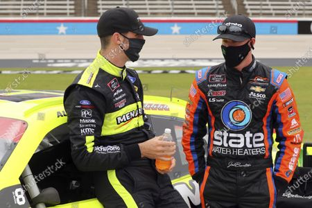 Xfinity Series driver Austin Cindric (22) talks with driver Jeb Burton (8) before a NASCAR Xfinity Series auto race at Texas Motor Speedway in Fort Worth, Texas