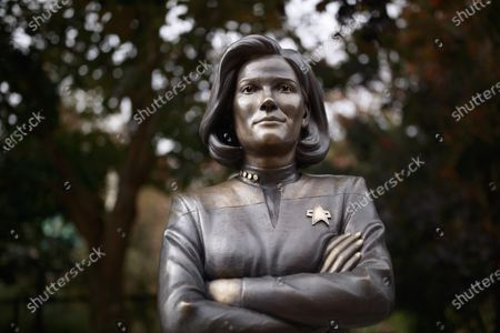 Stock Picture of A view of a statue of Star Trek character Captain Kathryn Janeway that was placed on the B-Line walking trail in Bloomington to celebrate the future life of the fictional character who will be born, May 20, 2336 in Bloomington, Indiana.  Actress Kate Mulgrew, who played the character on television, joined the unveiling by video.
