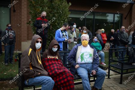 Star Trek fans wearing face masks gather for the unveiling of the Captain Kathryn Janeway statue placed on the B-Line walking trail in Bloomington to celebrate the future life of the fictional character who will be born, May 20, 2336 in Bloomington, Indiana.  Actress Kate Mulgrew, who played the character on television, joined the unveiling by video.