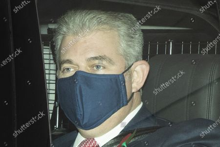 Secretary of State for Northern Ireland Brandon Lewis wears a mask as he departs the BBC after appearing on the Andrew Marr Show.