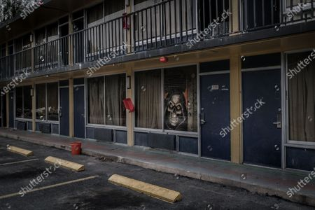 Exterior of the Star Motel, which is occupied by drug addicts, in Kissimmee, Orlando, USA, 20 October 2020. (issued 25 October 2020) The motels along Highway 192 in the state of Florida are today the reflection of the American economic collapse. Due to the high housing prices in Orlando driven by Disney World, low-income workers found the least expensive solution in motels, but with increasing social inequality and the arrival of the covid-19 pandemic that caused a peak in the number of unemployed these places have become uninhabitable, with many of the residents remaining illegally and with the owners of these spaces abandoning the motels.