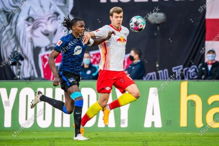 Alexander Soerloth (R) of RB Leipzig vies with Dedryck Boyata of Hertha Berlin during a German Bundesliga football match between RB Leipzig and Hertha Berlin in Leipzig, Germany, Oct. 24, 2020.