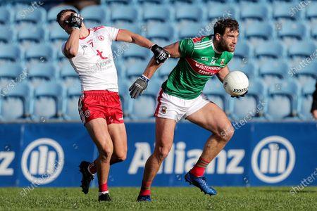 Mayo vs Tyrone. Mayo's Aidan O'Shea and Michael McKernan of Tyrone