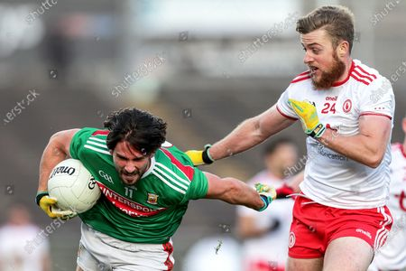 Stock Picture of Mayo vs Tyrone. Mayo's Mark Moran and Michael O'Neill of Tyrone