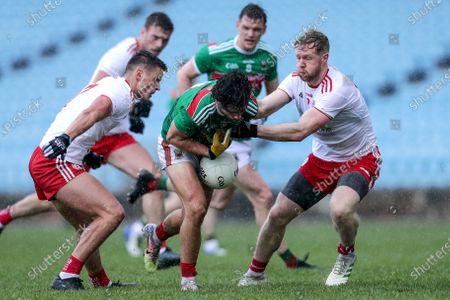 Stock Photo of Mayo vs Tyrone. Mayo's Mark Moran with Michael McKernan and Frank Burns of Tyrone