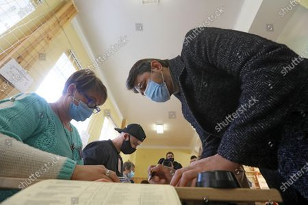 Kyiv city head hopeful, Ukrainian TV presenter and actor Serhiy Prytula receives ballots at a polling station as voting in the 2020 Ukrainian local elections is ongoing, Kyiv, capital of Ukraine.