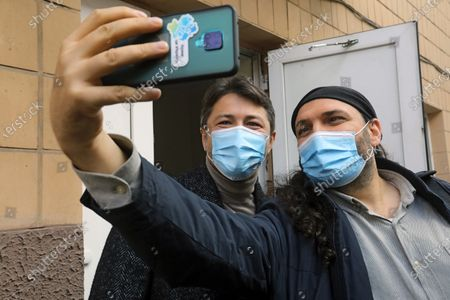 Kyiv city head hopeful, Ukrainian TV presenter and actor Serhiy Prytula (L) poses for a selfie with a voter upon voting in the 2020 Ukrainian local elections, Kyiv, capital of Ukraine.