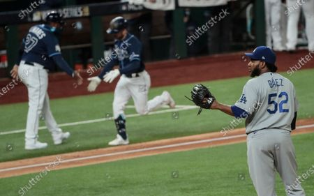 Stock Image of Arlington, Texas, Saturday, October 24, 2020 Los Angeles Dodgers relief pitcher Pedro Baez (52) gives up a 6th inning homer to Tampa Bay Rays second baseman Brandon Lowe (8) in game four of the World Series at Globe Life Field. (Robert Gauthier/ Los Angeles Times)
