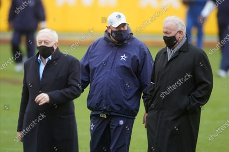 Dallas Cowboys head coach Mike McCarthy, center, walks off the field with team owner Jerry Jones, left, and Executive Vice President, CEO and Director of Player Personnel Stephen Jones, right, before the start of an NFL football game against the Washington Football Team, in Landover, Md