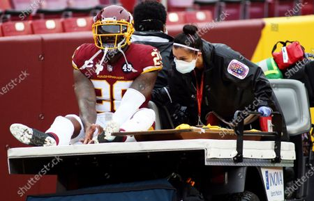 Washington Football Team strong safety Landon Collins (26) is carted off the field during an NFL football game against the Dallas Cowboys, in Landover, Md