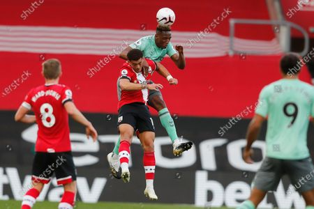 Everton's Yerry Mina, top, jumps for the ball with Southampton's Che Adams during an English Premier League soccer match between Southampton and Everton at the St. Mary's stadium in Southampton, England