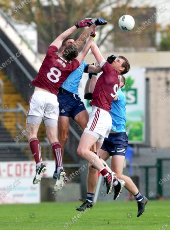 Galway vs Dublin. Galway's Cein D'Arcy and Tom Flynn contest James McCarthy and Brian of Dublin Fenton at the throw in