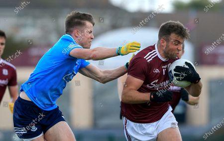 Galway vs Dublin. Dublin's Robert McDaid tackles Paul Conroy of Galway