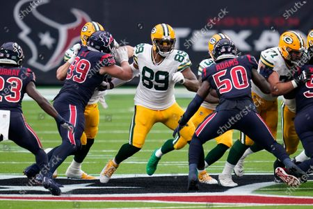 Green Bay Packers tight end Marcedes Lewis (89) runs up field during the first half of an NFL football game against the Houston Texans, in Houston