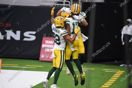 Green Bay Packers wide receiver Davante Adams (17) is congratulated by teammates Marcedes Lewis (89) and Darrius Shepherd (82) after catching a 45-yard touchdown pass during the second half of an NFL football game against the Houston Texans, in Houston
