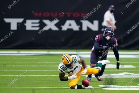 Green Bay Packers running back Dexter Williams (22) is unable to recover a punt blocked by the Houston Texans during the second half of an NFL football game, in Houston. The Texans' Dylan Cole recovered the punt