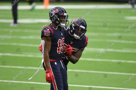 Houston Texans wide receiver Randall Cobb (18) laughs with teammate Duke Johnson before the start of an NFL football game against the Green Bay Packers, in Houston