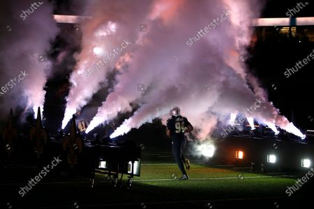 New Orleans Saints defensive end Cameron Jordan (94) runs onto the field during player introductions before an NFL football game against the Carolina Panthers in New Orleans